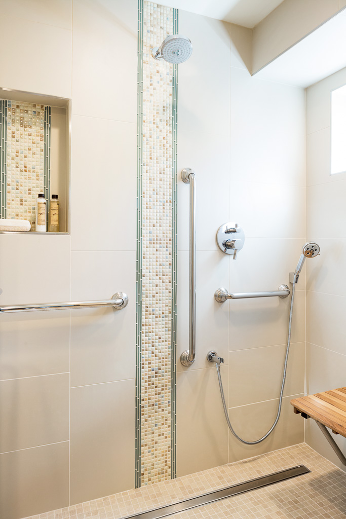 Tiled shower with grab bars and fold down seat