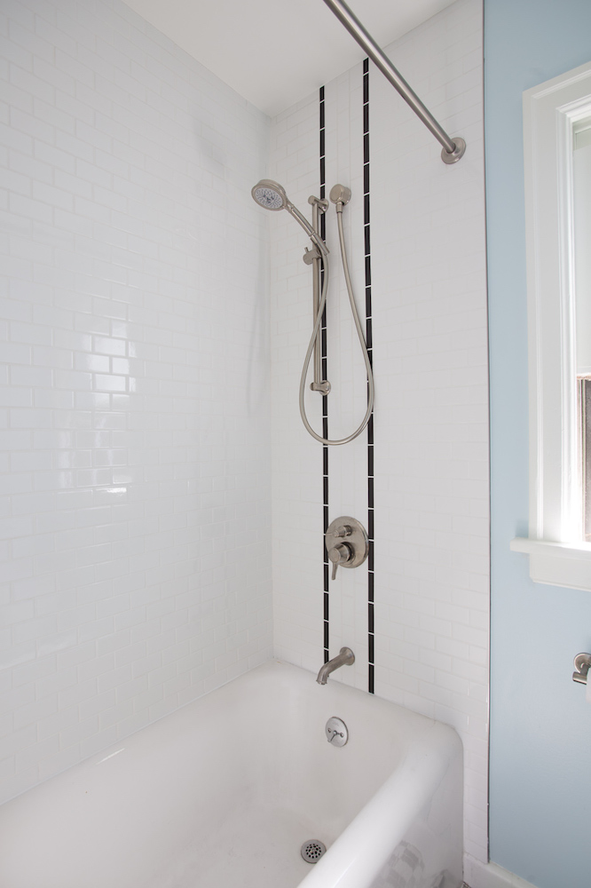 new bath and shower with white tile