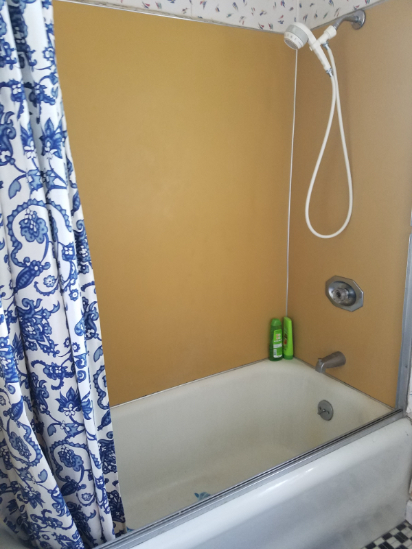old shower with yellow walls